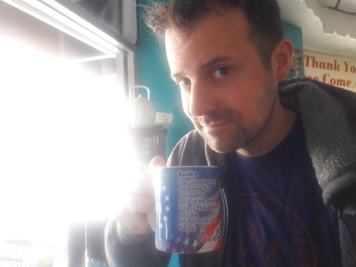 Tom drinking coffee.