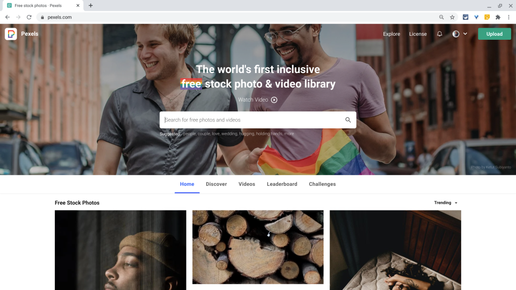 """The home screen of the Pexels.com website. The tagline reads, """"The world's first inclusive free stock photo & video library."""""""