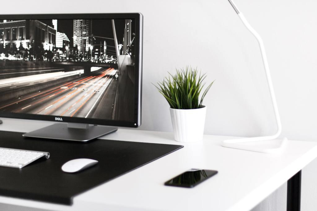 A Dell computer screen on a white desk.